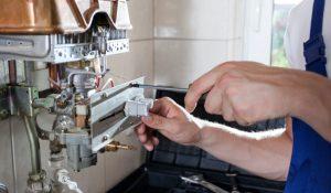 Plumber Repairing Hot Water Heater 1024x597 1